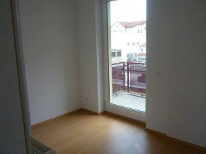 11_schlafzimmer_mit_balkon